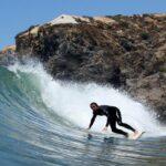 Odeceixe Surfer catching wave in Algarve