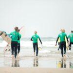 Odeceixe surfer walking into Sea